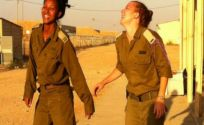 Zehava Elias was born during her family's two-year ordeal from Ethiopia to Israel. Now she is an IDF officer, seen here with a friend on the right.