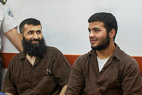 Ziad Awad (L) and his son Izz Eddin (R) at Ofer Military court on June 23, 2014. The two were arrested on May 7 for the April 14 shooting of Baruch Mizrahi