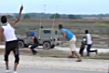 Arabs breach the Gaza security fence and attack IDF patrol jeeps with rocks.
