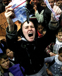 Rachel Corrie burns a mock U.S. flag during a rally in the southern Gaza town of Rafah in February 2003. photo/ap/khalil hamra