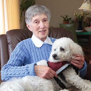 senior with Canine Companion volunteer