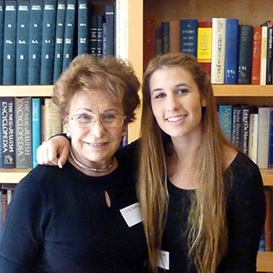Holocaust survivor and teen pose together for a photo at Next Chapter graduation
