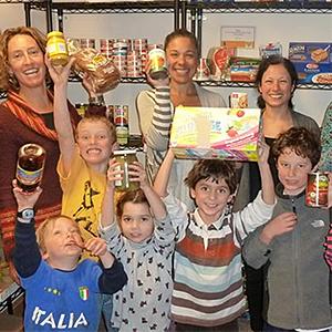 photo of volunteers bringing food to the food pantry