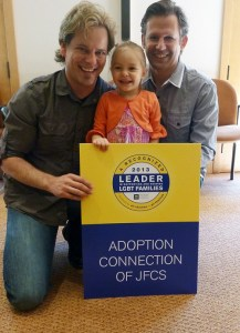 Adoptive dads, Michael and Mike, celebrate the HRC award with Adoption Connection and their daughter, Calliope.