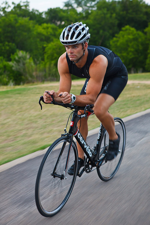 male triathlete on bike