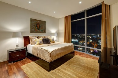 Photograph of a bedroom in the Austonian building.