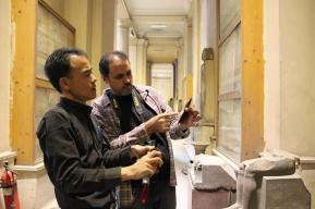 Checking the condition of the wall painting