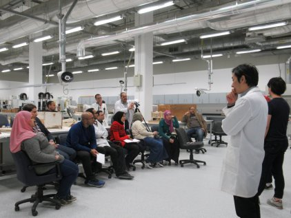 Japanese experts giving lecture how to use the analysis instruments