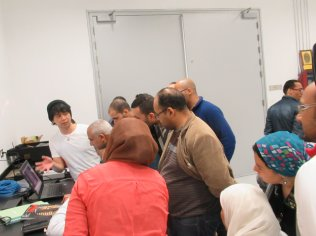 Japanese experts giving lecture about how to use the analysis instruments