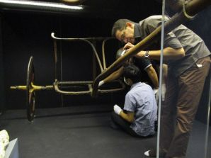 Dr. Hussein and Mr. Okada checking the condition of Tut's Chariot