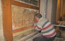 Inspecting the mural paintings