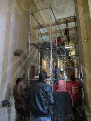 Conservators take the wall paintings off the wall of the Egyptian Museum, Altahrir