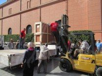 Taking the Wall Paintings out of the Egyptian Museum at AlTahrir after Packing them