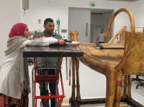 The conservators preparing the X-Ray photography device