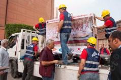 loading the mural paintings on trucks
