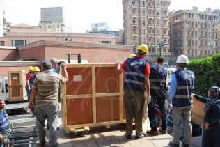 the transportation team prepares for moving the boxes into the transportation trucks