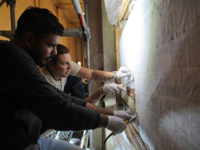 Mural painting conservators on the scaffolds doing the first aid