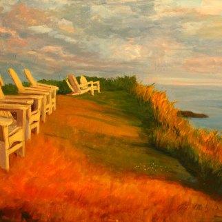 Monhegan Adirondacks sit on the hill over the harbor soaking in the Monhegan Island Sunset