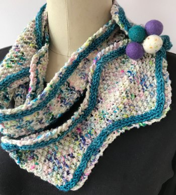 Tangiers in It Could Be Worsted in two colors. Unique closure allows it to be worn as a cowl