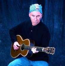 Jim sitting with blue bg