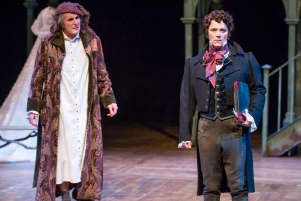 Scrooge (Sam Gregory) looking at his past self (Jim Poulos) - Photo: Sam Adams