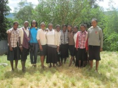 The author (in blue) pictured with Jitegemee students during her first visit to the school.