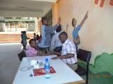 Mr. Kilonzo, our program doctor, checks our primary school students.