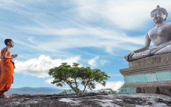 Buddhist with Buddha Statue