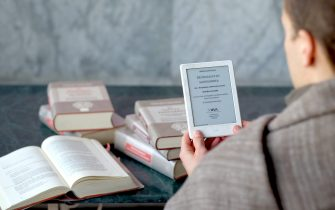 Devotee reading Sandarbha E-book