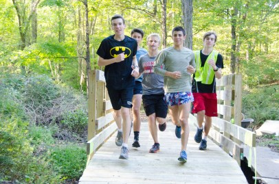 John Jay High School Cross Country Varsity Boys team Class of 2018 members cross the newly completed bridge on the John Jay Community Trail. Left to right: Brendan Carroll, Will Kennedy, Mills Reed, Ed Soriano, Zach Kells