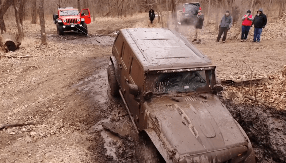 Jeep JL tows JK out of icy mud