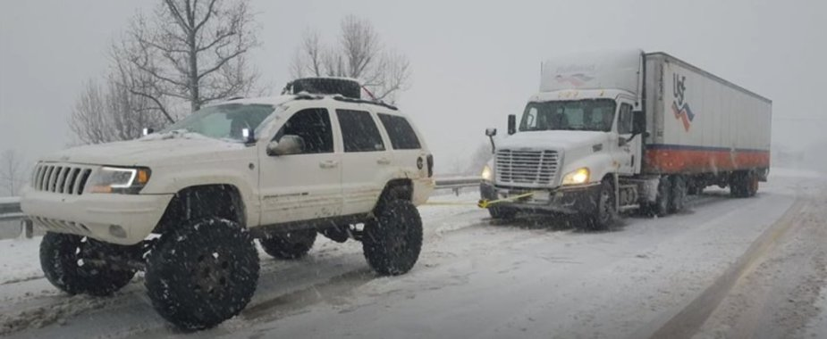 Jeep Grand Cherokee Pulling a Tractor Trailer