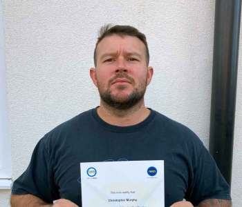 christopher murphy with certificate