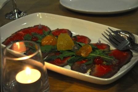 Beef carpaccio and magic fruits