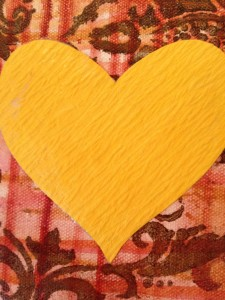 close up of yellow heart on canvas
