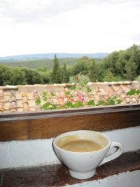 a latte on a windowsill overlooking the Italian countryside which was a reward for meeting my personal goal of Creating my Inspired Life