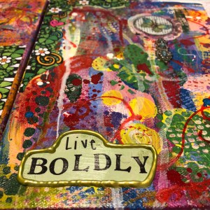 "a colorful collage with the mandate to ""Live Boldly"" in the lower left corner"