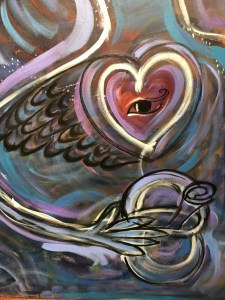 Winged heart with an eye in the center