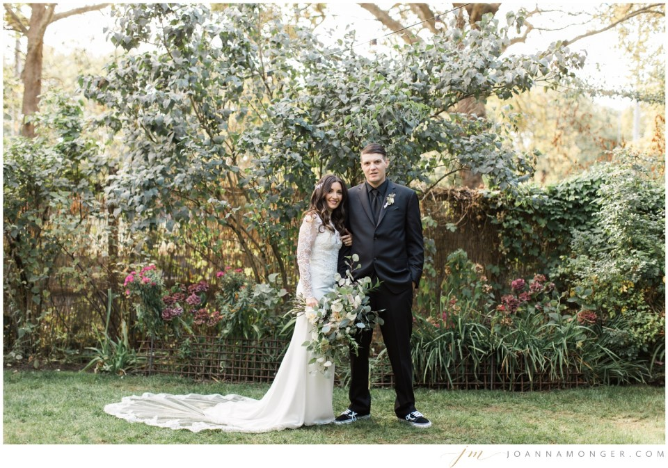 A bride and groom pose for a photo during their gorgeously-detailed wedding at the Corson Building in SODO, Seattle, WA. | Joanna Monger Photography | Snohomish & Seattle Wedding Photographer