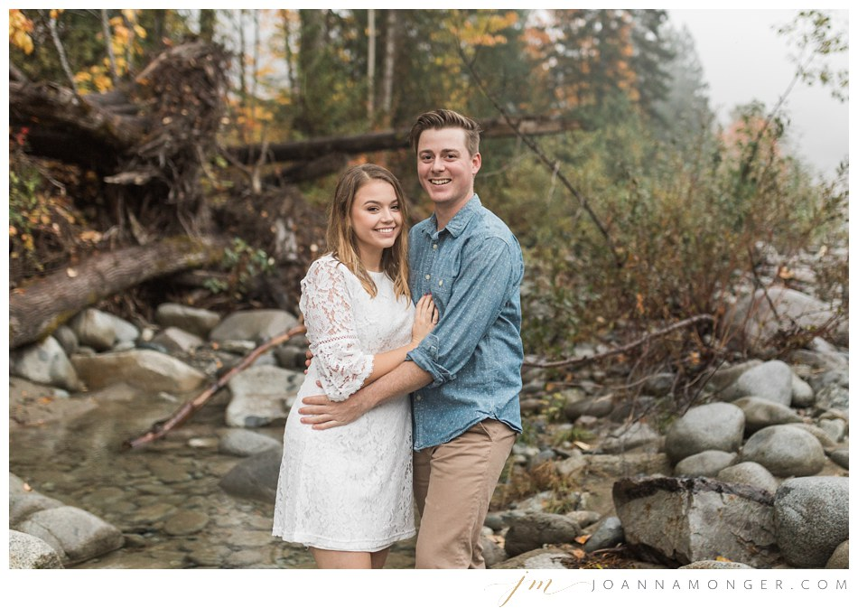 A couple embraces during their mountain engagement shoot in Snohomish, WA. | Joanna Monger Photography | Snohomish & Seattle Wedding Photographer