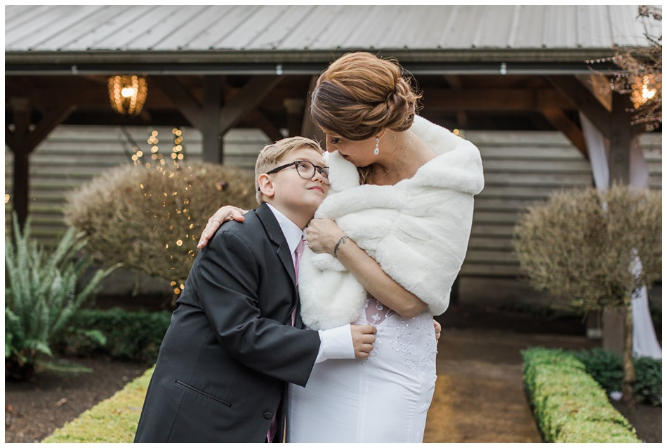 A son lovingly looks at his mom before her a special winter wedding at Hidden Meadows, a wedding venue in Snohomish near Seattle, WA. | Joanna Monger Photography | Snohomish & Seattle Wedding Photography