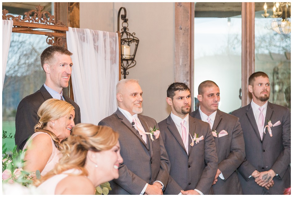A groom stands with his groomsmen as he watches his bride walk down the aisle during their special winter wedding at Hidden Meadows, a wedding venue in Snohomish near Seattle, WA. | Joanna Monger Photography | Snohomish & Seattle Wedding Photography