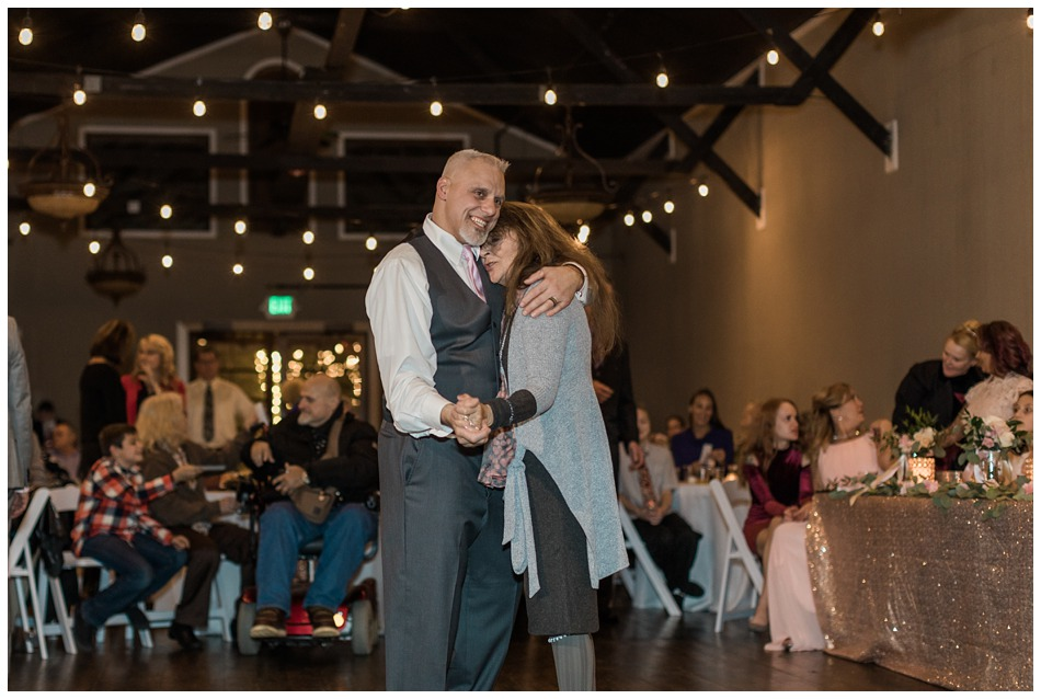 A groom dances with a loved one during his special winter wedding at Hidden Meadows, a wedding venue in Snohomish near Seattle, WA. | Joanna Monger Photography | Snohomish & Seattle Wedding Photography