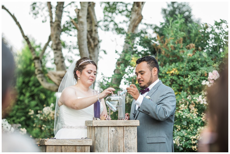 Photo of bride and groom during their ceremony at a rustic barn wedding at Craven Farms in Snohomish, a wedding venue near Seattle. | Joanna Monger Photography