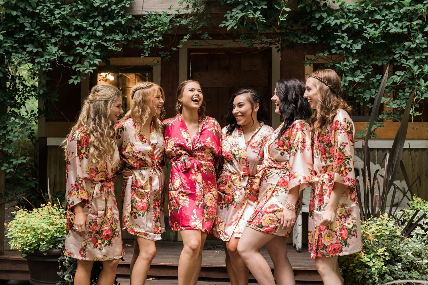 A bride laughs with her bridesmaids as they get ready for her summer wedding at Maroni Meadows in Snohomish, a wedding venue near Seattle, WA. | Joanna Monger Photography | Seattle & Snohomish Photographer