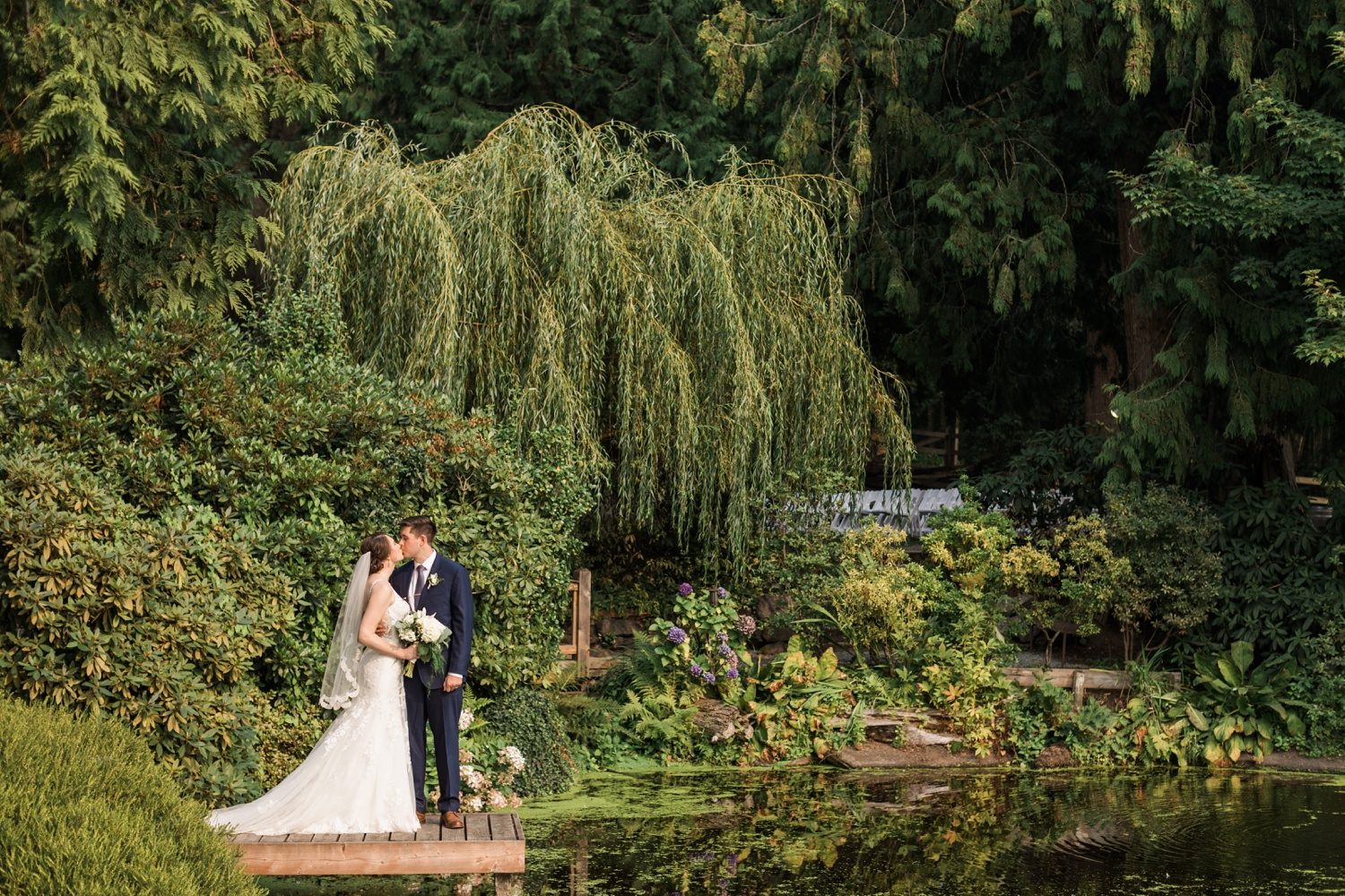 A bride and groom kiss in a beautiful garden before their wedding at Chateau Lill in Woodinville, a wedding venue near Seattle, WA. | Joanna Monger Photography | Seattle & Snohomish Photographer