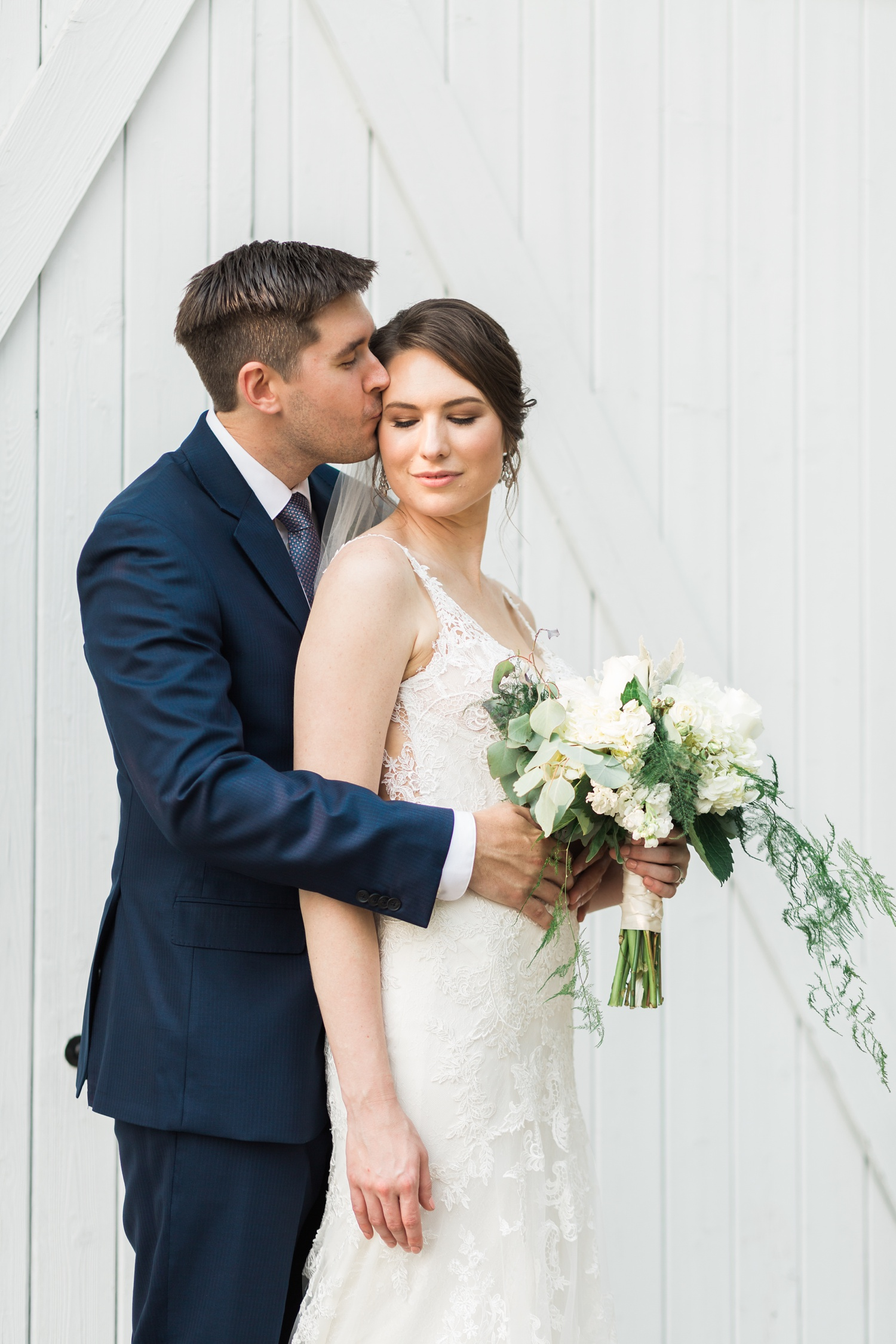 A groom kisses his bride before their wedding at Chateau Lill in Woodinville, a wedding venue near Seattle, WA. | Joanna Monger Photography | Seattle & Snohomish Photographer