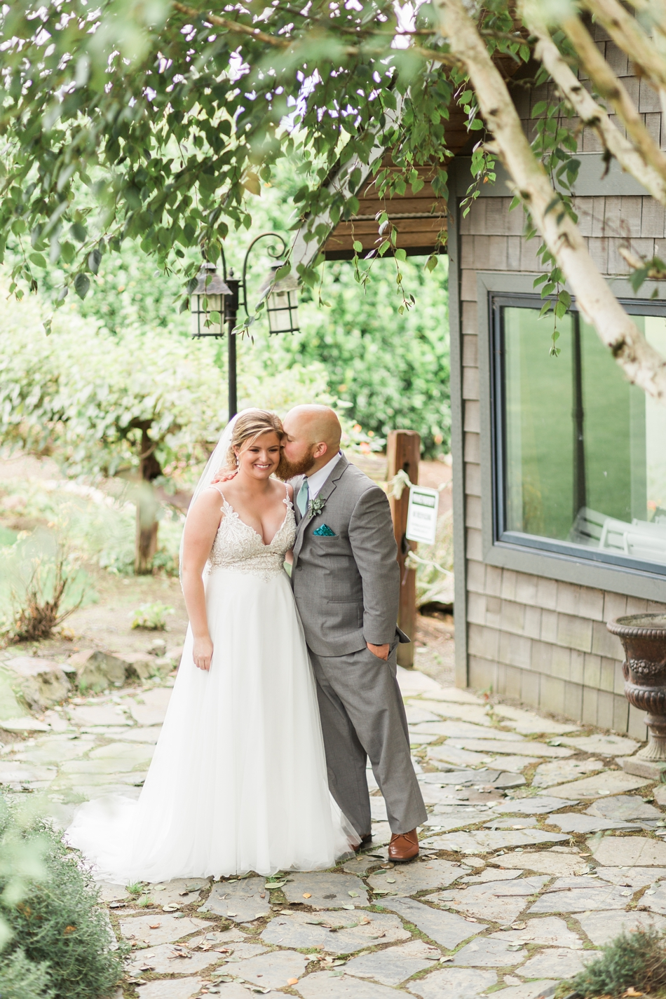 Photo of groom kissing bride at a Hidden Meadows Farms wedding in Snohomish, a rustic yet elegant wedding venue near Seattle. | Joanna Monger Photography