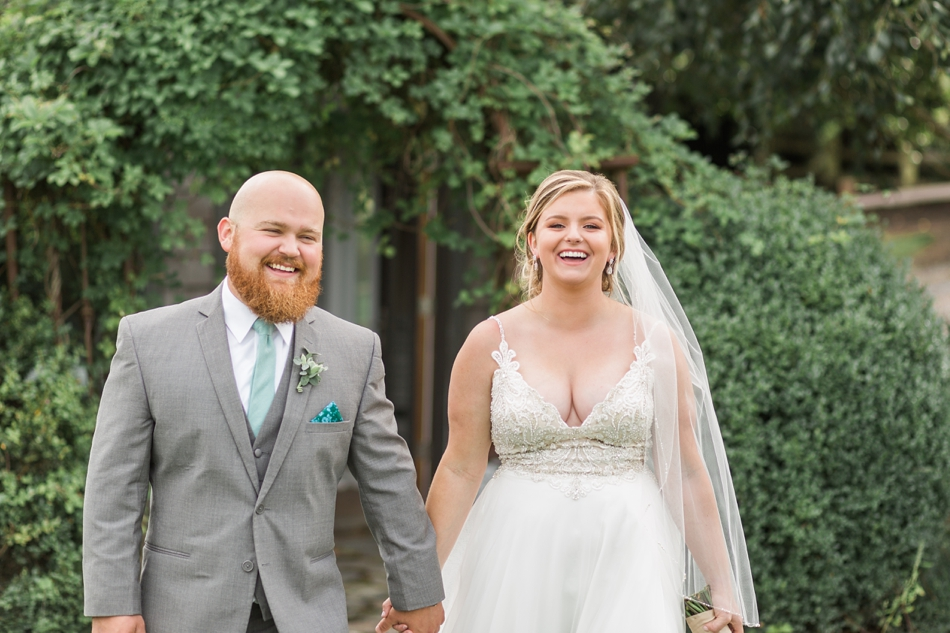 Photo of bride and groom laughing at a Hidden Meadows Farms wedding in Snohomish, a rustic yet elegant wedding venue near Seattle. | Joanna Monger Photography