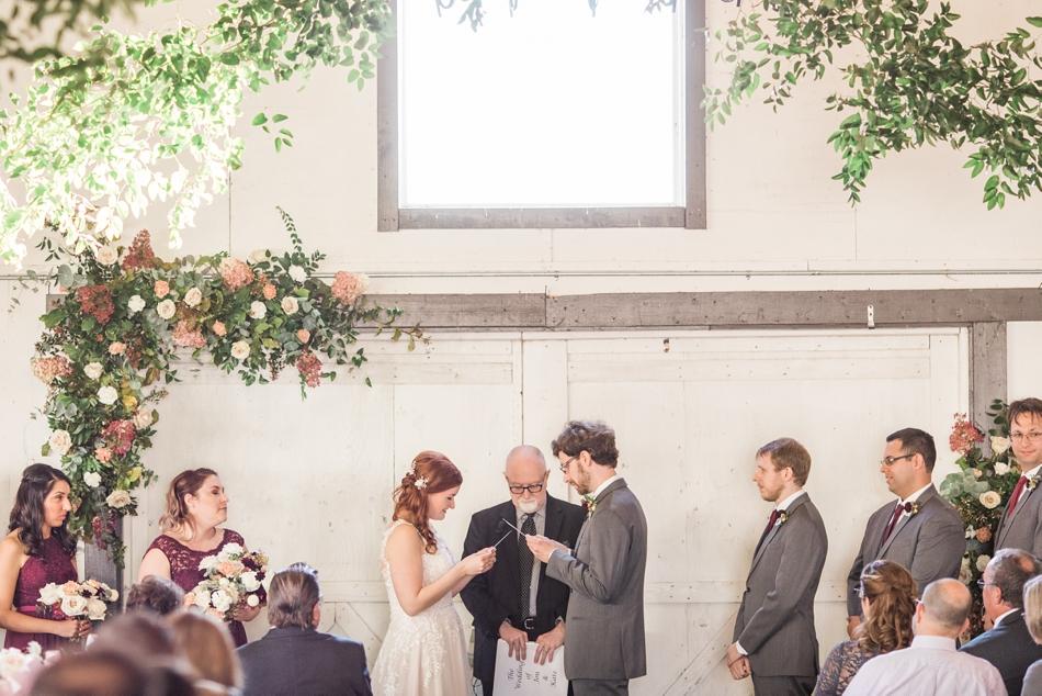 Photo of wedding ceremony at Snohomish Wedding Venue Dairyland Barn near Seattle | Joanna Monger Photography